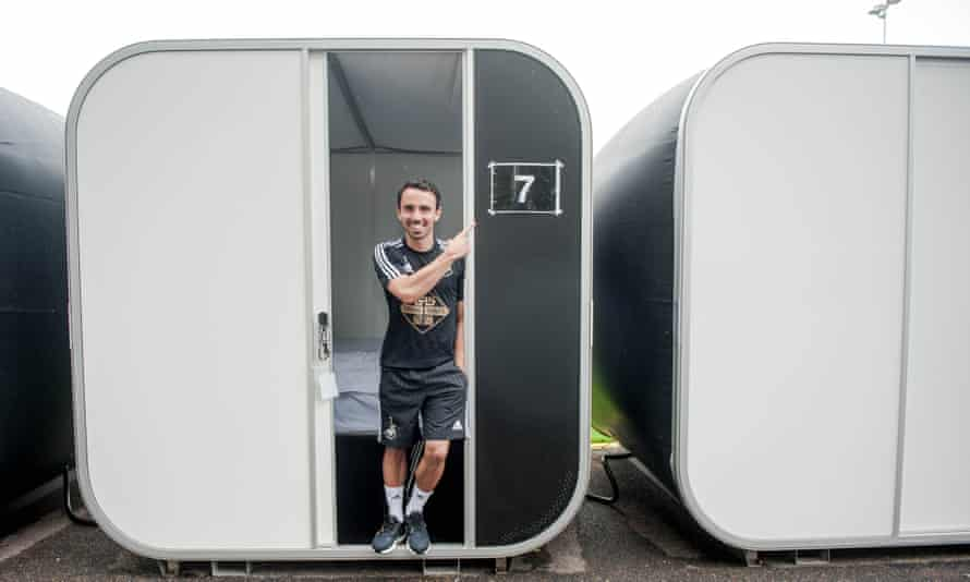 Leon Britton stands in his 'Snoozebox' at Swansea's training ground. The club has installed 30 of them for players to sleep in between sessions.