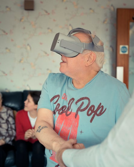 A resident of Woffington house enjoys a VR experience.