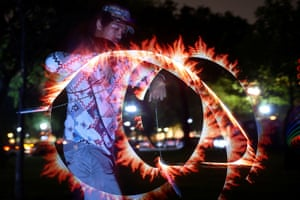 A man dances with light at an event called Catharsis on the Mall in the Capitol