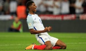 Marcus Rashford celebrates scoring to make it 2-1 England.