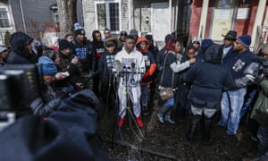 Activists, family and neighbors gather to speak to the media after the shooting.