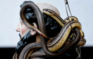 A statue of Saint Domenico covered with live snakes is carried by devotees during an annual procession in the streets of Cocullo, a village in the Abruzzo region.