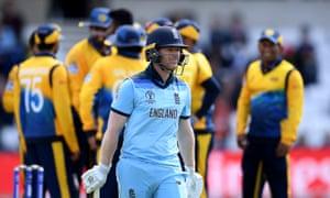 Eoin Morgan of England walks off after being dismissed by Isuru Udana of Sri Lanka.