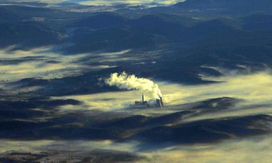 A coal fired power station shrouded in morning mist