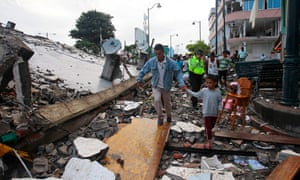 People walk among the debris after a 7.8 magnitude earthquake hit the north coast of Ecuador.