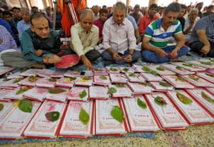 Indian businessmen pray