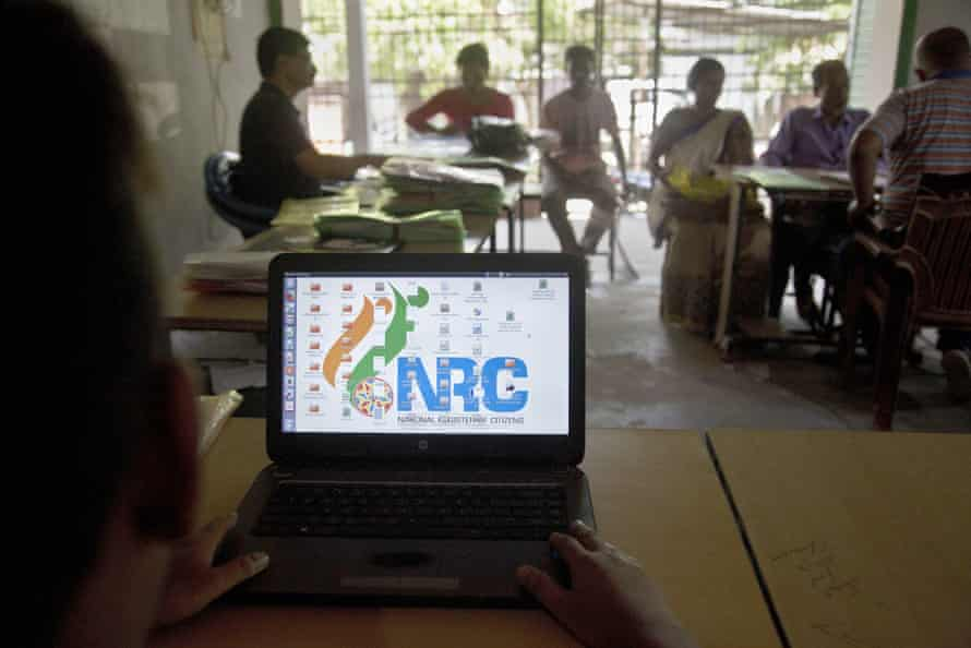 National Register of Citizens officers attend to customers at an centre in Guwahati, India, on 30 August.
