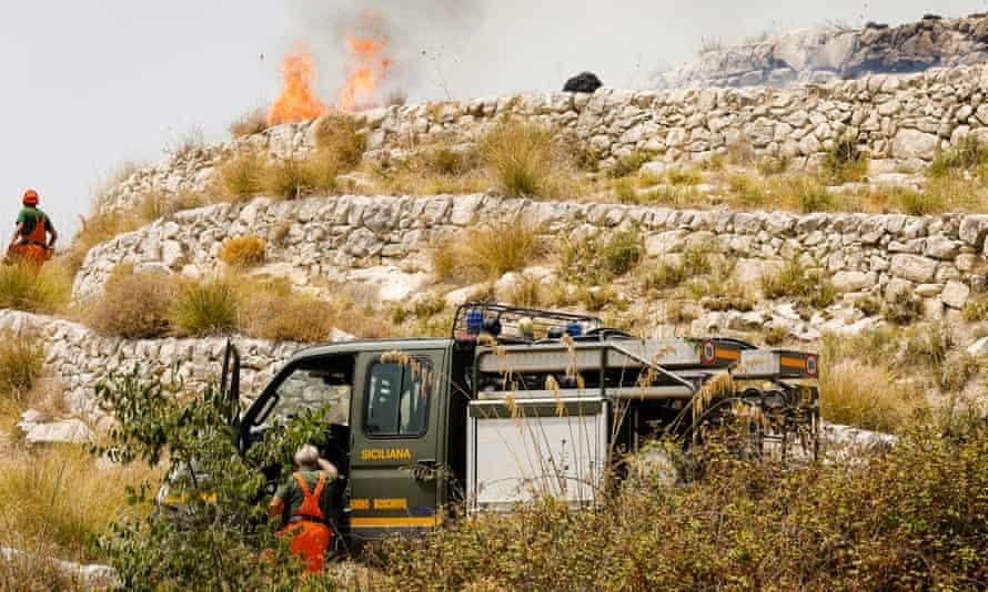 Firefighters battle a blaze in Ragusa, Sicily