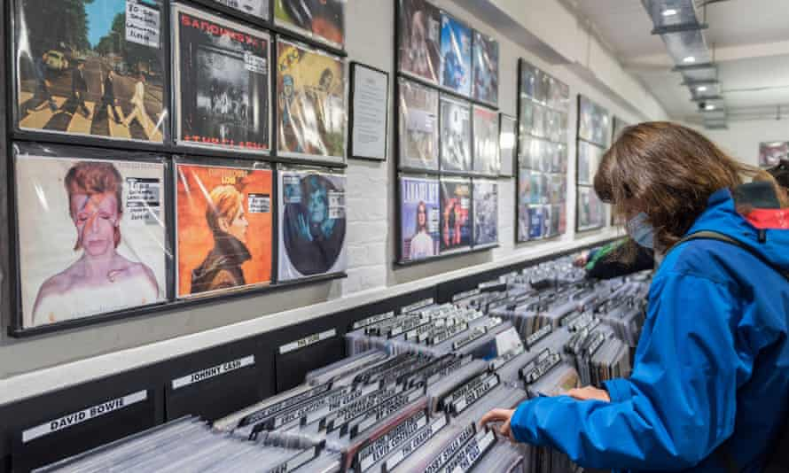 A customer browses vinyl records in a shop in London