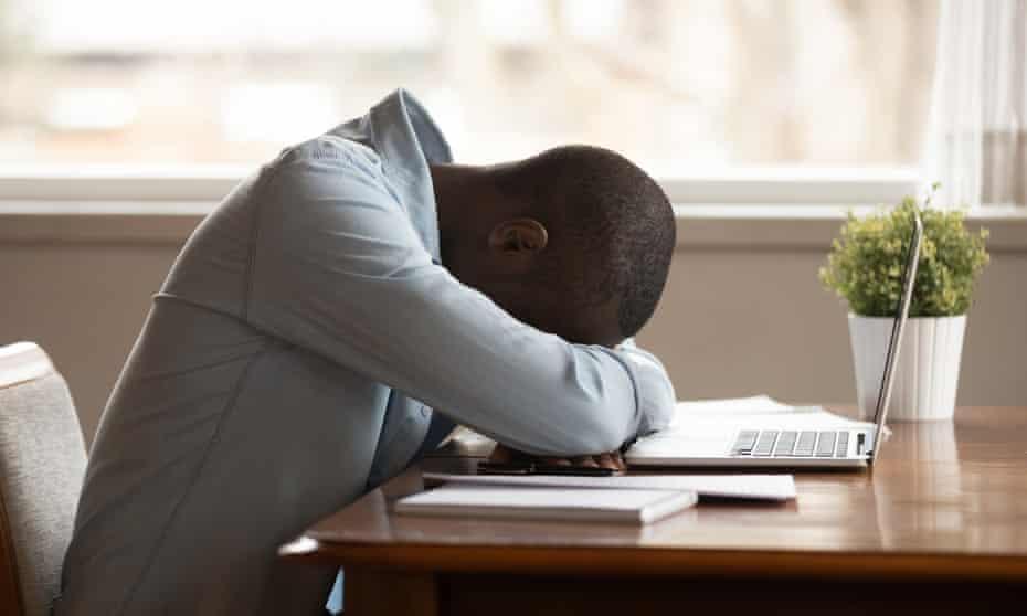Man falls asleep working at laptop