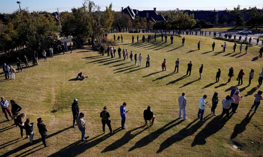 Voters wait in a long line to cast their ballots at Church of the Servant in Oklahoma City on 3 November 2020. A sign of a healthy democracy or the opposite?