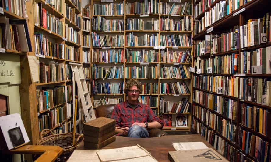 'This is a man who shot a Kindle and wall-mounted it': Shaun Bythell in his Wigtown bookshop