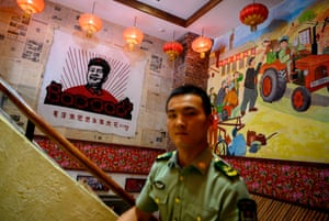 A poster of Mao at a restaurant in Beijing
