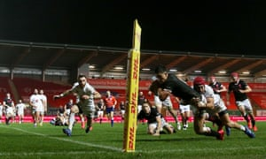 Wales' Louis Rees-Zammit (right) scores his side's first try.