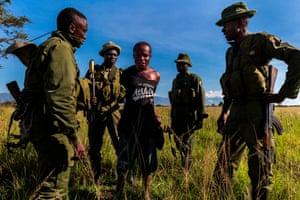 Conservation rangers capture a poacher at a camp inside Virunga national park