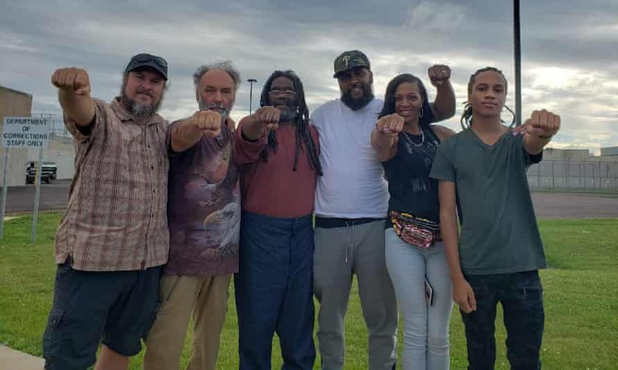 Eddie Goodman Africa, middle in ochre shirt and blue trousers, is flanked by family members and supporters outside Mahanoy prison in Frackville, Pennsylvania.