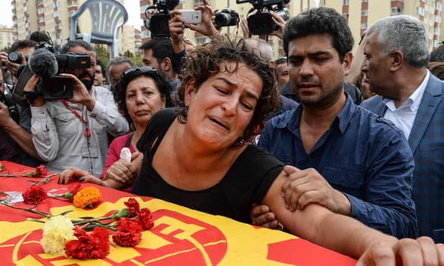 Family members of Korkmaz Tedik mourn over his coffin in Ankara