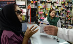 A woman gets medication from a Tehran pharmacy. Although medicines are not under sanctions, the value of the rial and banking disruption has resulted in shortages.