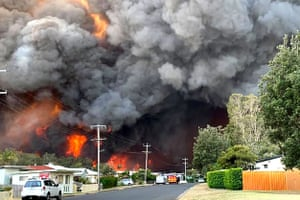 "Harrington, Australia Flames from an out of control bushfire in Harrington, some 335 kilometres northeast of Sydney. Firefighters warned they were in ""uncharted territory"" as they struggled to contain dozens of out-of-control bushfires across the east of the country"