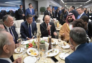 At half-time there's no sign or a pie or a mug of Bovril as Russian President Vladimir Putin, Saudi Crown Prince Mohammed bin Salman and other guests chow down
