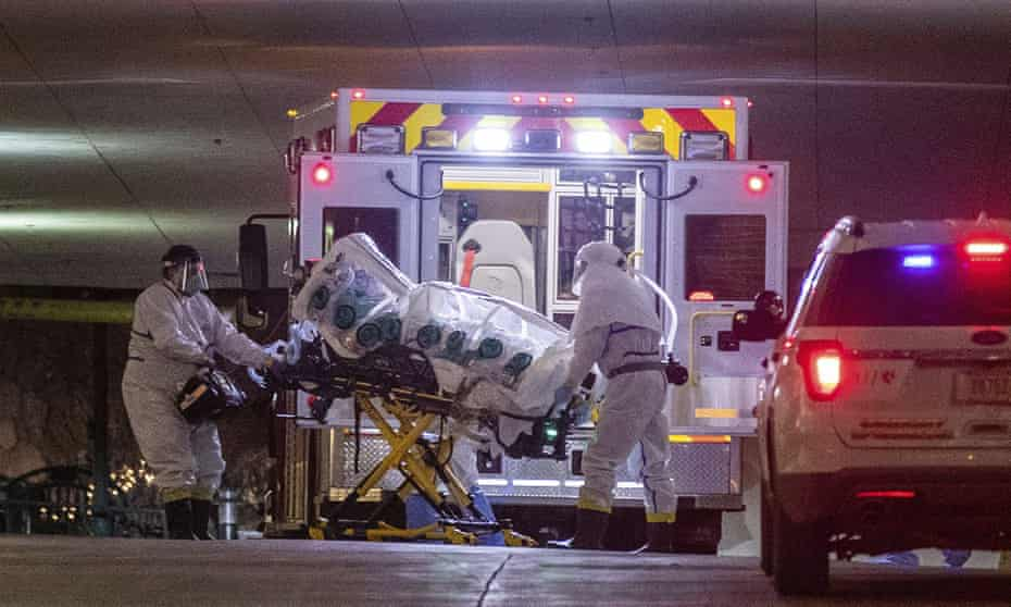 Just 20 beds available … a woman with coronavirus is brought to the University of Nebraska Medical Center in an isolation pod.