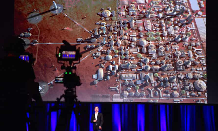Elon Musk, founder of SpaceX, during a presentation at the International Astronautical Congress in Adelaide. On screen: a depiction of a human colony on the planet Mars.