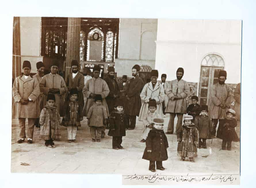 Based on the caption written by Masoud Mirza Zell-e-Soltan, the photographer of this image was his chief slave, Aqabaji. In this picture four of Zell-e-Soltan's adult African slaves are seen keeping an eye on his children, Chehel Sotun Palace, Isfahan. 1890s