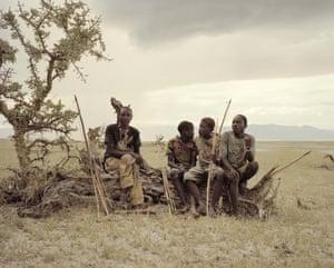 Giaga Manu, Osama and Madenye resting on a dead tree