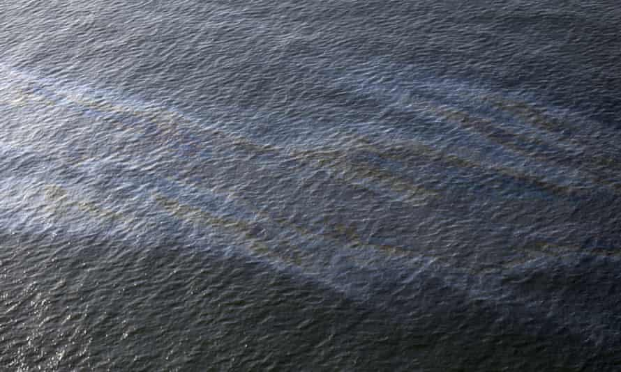 """Taylor Energy oil spill<br>FILE - This March 31, 2015, file photo shows an oil sheen drifting from the site of the former Taylor Energy oil rig in the Gulf of Mexico, off the coast of Louisiana. A federal lawsuit that Taylor Energy Co. filed Thursday, Dec. 20, 2018, in New Orleans asks the court to throw out Coast Guard Capt. Kristi Luttrell's Oct. 23 administrative order. The suit claims the Coast Guard's actions ignored """"well-verified scientific conclusions"""" and were taken in response to """"adverse publicity.""""(AP Photo/Gerald Herbert, File)"""