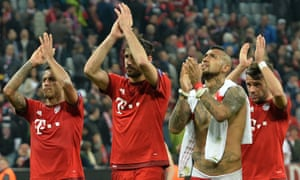 Bayern's goalscore Arturo Vidal, second right, celebrates with team-mates at the end of the match.