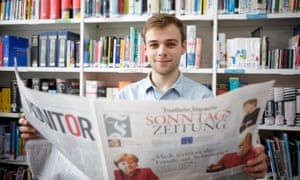 Language student George Hope at Southampton university reads a German newspaper.