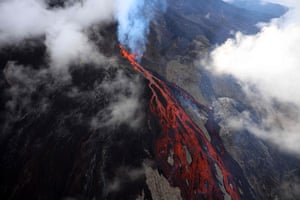 Lava flows down the erupting Piton de le Fournaise volcano on the French island of Réunion