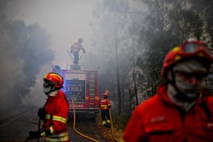 Firefighters tackle a wildfire in Sardoal in Santarém district on Thursday.