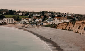 Daniel Payne, who was convicted of drug smuggling along with four other fishermen on the Isle of Wight in 2011, walks his dog Drago along the beach at Freshwater Bay, near to where the drug parcels were discovered. Payne has always maintained his innocence. Freshwater, Isle of Wight, UK. 20th March 2020.