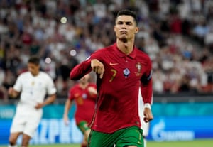 Cristiano Ronaldo celebrates after scoring from the penalty spot.