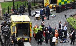 Paramedics and police outside the Palace of Westminster after a terrorist attack