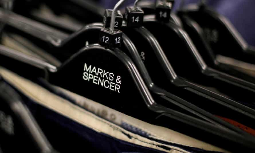Clothes displayed on hangers in a Marks & Spencer store