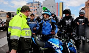 Motorcyclists with police in Bogotá.