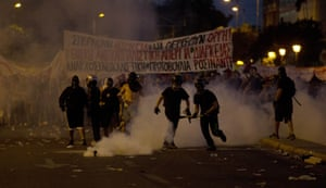 Anti-austerity protesters clash with riot police during a rally in Athens.