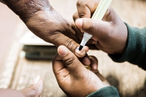 A voter gets her thumb marked at a polling station in Cottanlands, north of Durban