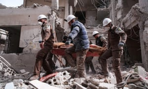 Syrian civil defence volunteers, known as the White Helmets, search for survivors after an airstrike.
