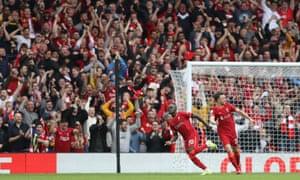 Sadio Mané celebrates his second goal with Diogo Jota as Anfield erupts.