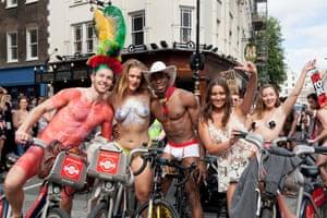 Participants cycle past Covent Garden