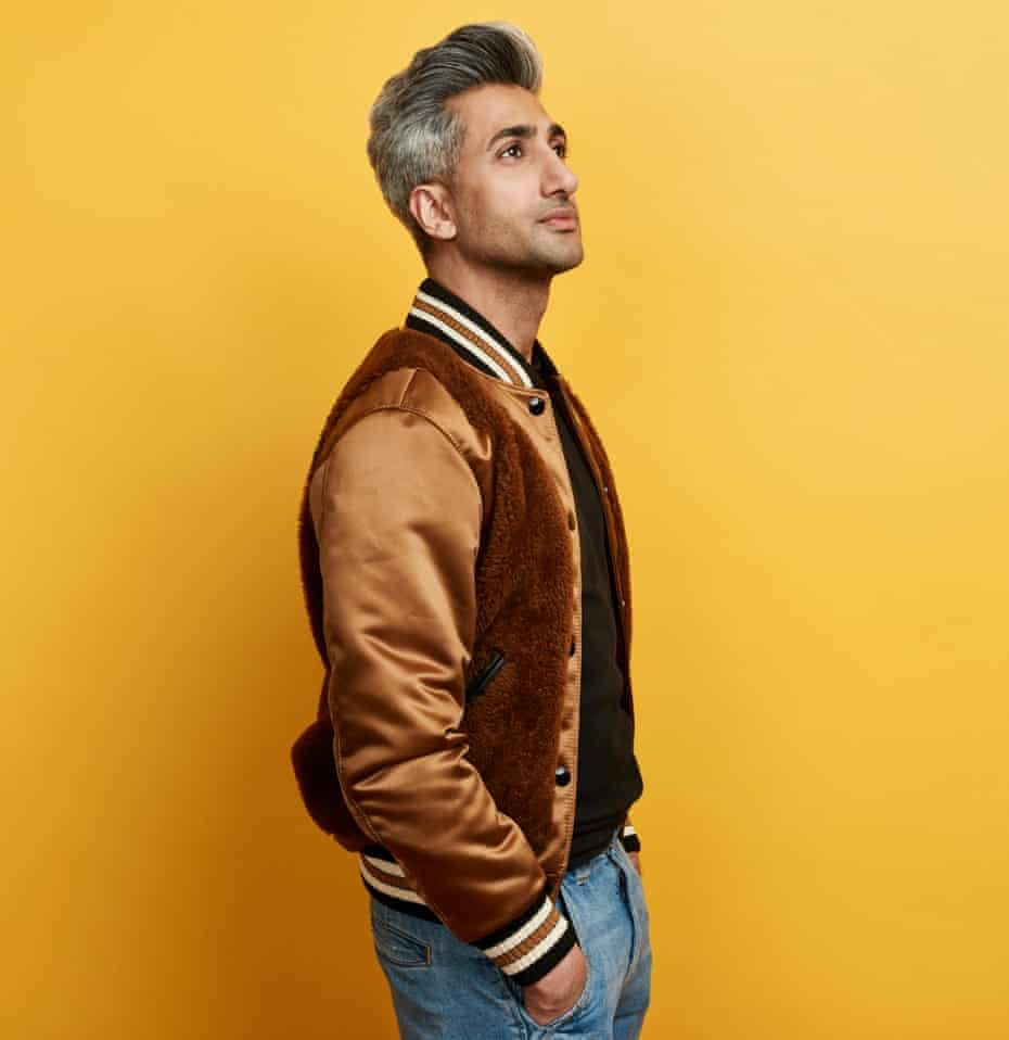 Tan France from Queer Eye, shot against a yellow background, Feb 2019