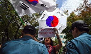 Supporters of South Korea's ousted president Park Geun-Hye wave national flags during a protest demanding the release of Lee Jae-Yong in Seoul on Friday.