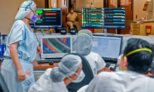 Health workers check monitors at the Intensive Care Unit (ICU) of the General Hospital, in Medellin, Colombia, on August 20, 2020. (Photo by JOAQUIN SARMIENTO / AFP)