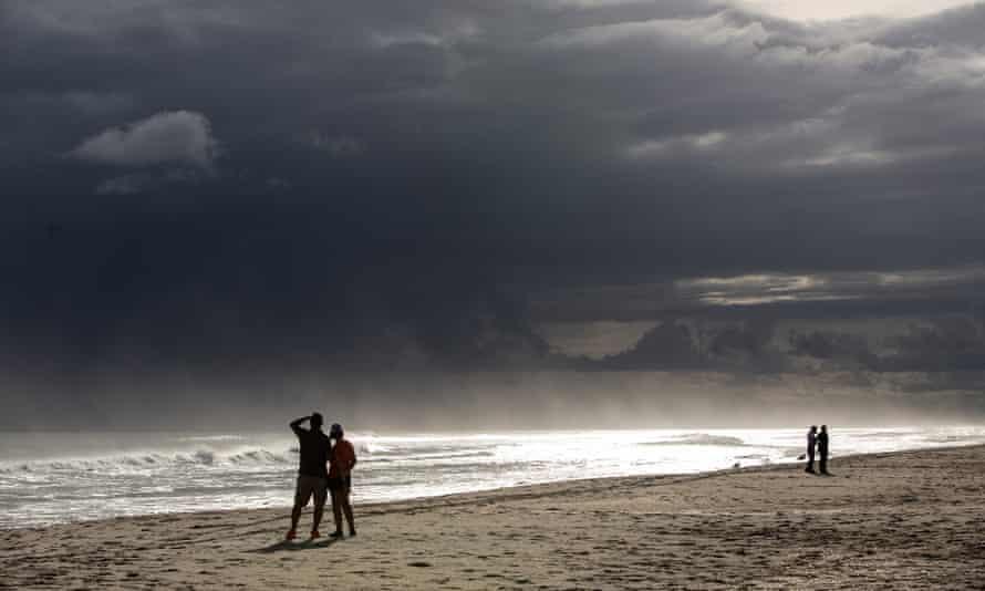 People in Atlantic Beach, North Carolina watch as Hurricane Florence threatens the Carolinas on 12 September 2018.