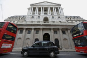 A taxi and buses queue outside the Bank of England in London.