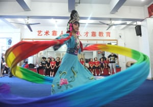 Huainan, China Zhao Zhiting twirls her costume while rehearsing for the Peking opera in Anhui province