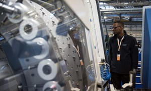 An apprentice operates an aircraft component fabrication machine in the Boeing Sheffield factory